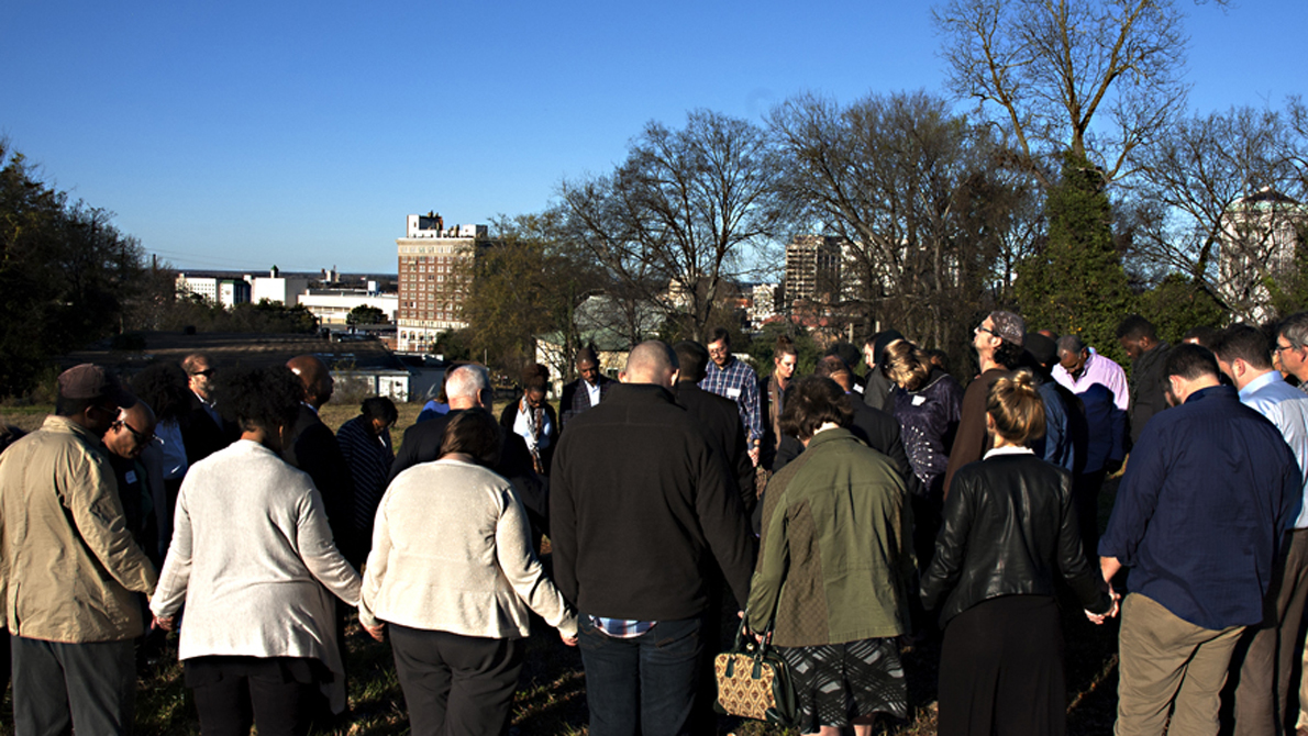 Sojourners faith retreat group prays at site of National Memorial in December 2015