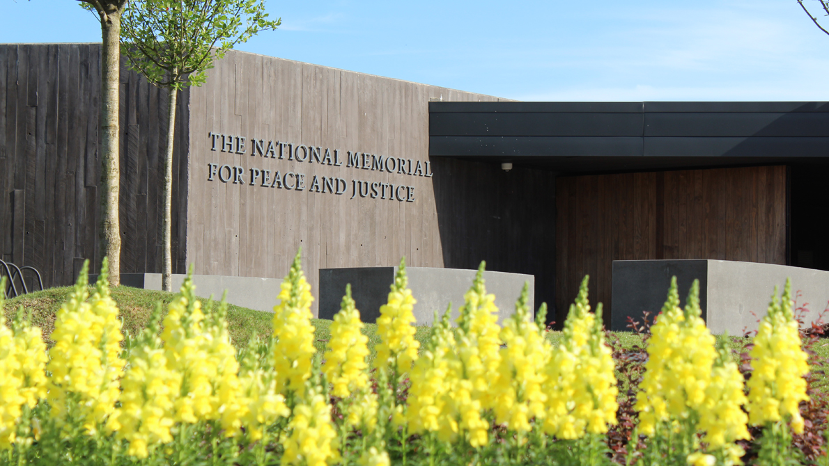 National Memorial for Peace and Justice entrance with yellow flowers.