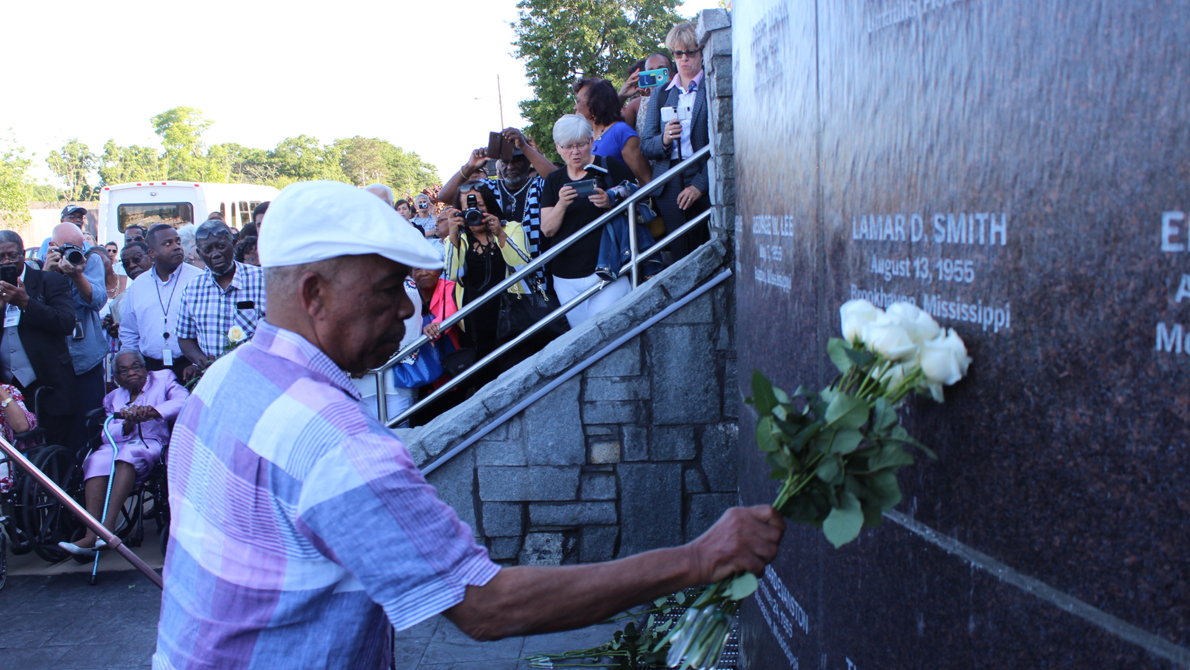 Roses placed at monument during dedication ceremony.